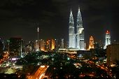 stock photo of petronas twin towers  - kuala lumpur city night scene - JPG
