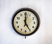 image of bakelite  - Bakelite vintage clock on a white wall - JPG