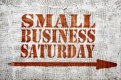 Small business Saturday  - graffiti sign with arrow on stucco wall poster