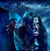 Undead zombie scary girl on halloween graveyard at night on dark clouds sky background. Dangers woma poster