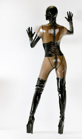 stock photo of latex woman  - standing woman wearing latex clothes - JPG
