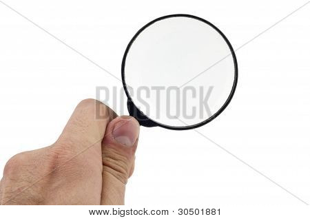 Magnifying glass holding human hand