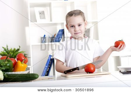 girl cooking vegetables