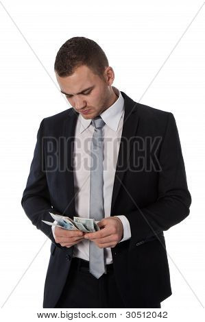 Businessman Is Counting Money; Isolated On White