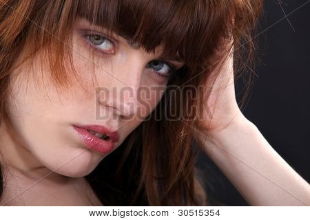 Rebellious woman with unkempt hair