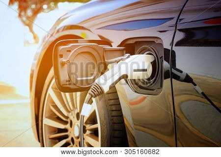 poster of Charging Modern Electric Car Battery On The Street Which Are The Future Of The Automobile, Close Up