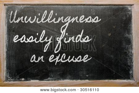 Expression -  Unwillingness Easily Finds An Excuse - Written On A School Blackboard With Chalk