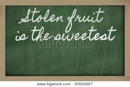 Expression -  Stolen Fruit Is The Sweetest - Written On A School Blackboard With Chalk