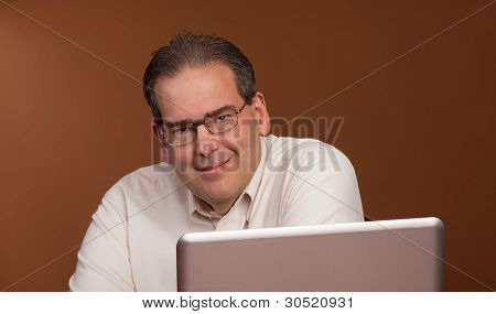 Smiling Middle Age Man At Computer
