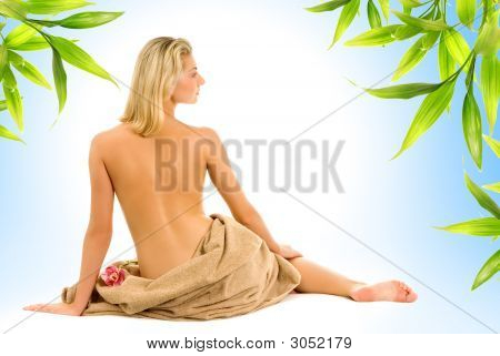 Beautiful Young Woman And Bamboo Leaves Around Her