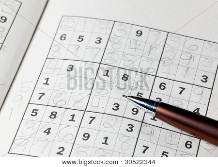 Pencil Resting On Sudoku Book