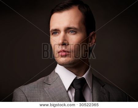 Man in grey suit portarit.