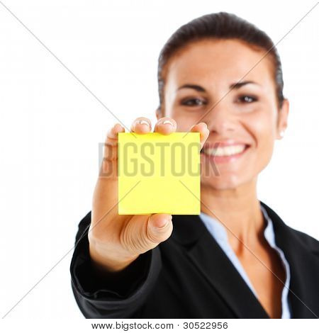 Beautiful businesswoman showing a blank post-it. You can add your own text