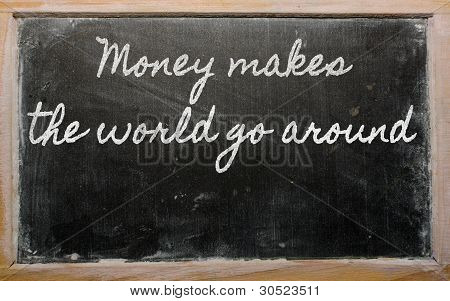 Expression -  Money Makes The World Go Around - Written On A School Blackboard With Chalk