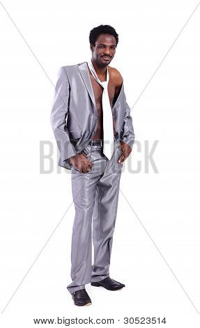 Closeup of a muscular handsome black businessman in suit with tie isolated on white