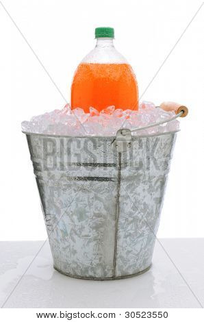 An orange two liter soda bottle in a metal bucket full of ice on a wet countertop. Vertical format over a white background.