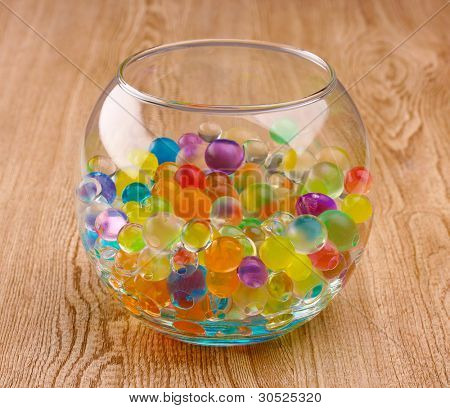 Color hydrogel in vase on wooden background