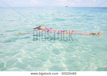Young Girl Relaxing In Tropical Sea