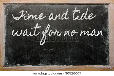 Expression -  Time And Tide Wait For No Man - Written On A School Blackboard With Chalk