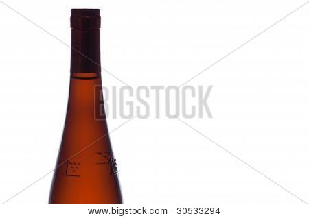 Wine Bottle Before A White Background