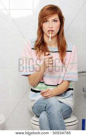 Teen girl caught on smoking in bathroom