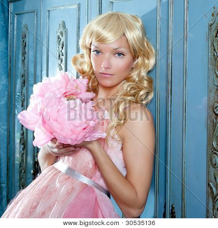 blond fashion princess and vintage spring flowers dress on blue wardrobe
