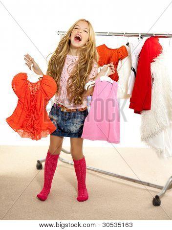 fashion victim kid girl at backstage wardrobe choosing clothes
