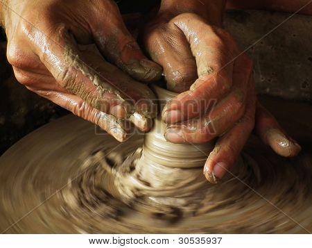 Close-up Of Potter Turning A Pot On A Potter