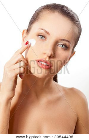 woman portrait with cream on face