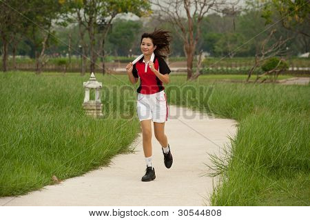 Woman Jogging In The Park.