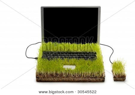 Laptop and Mouse Made Out Of Gras on white background