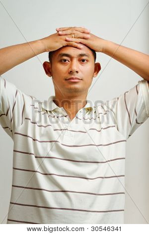 Handsome Ethnic Young Man Placed Hands On Head