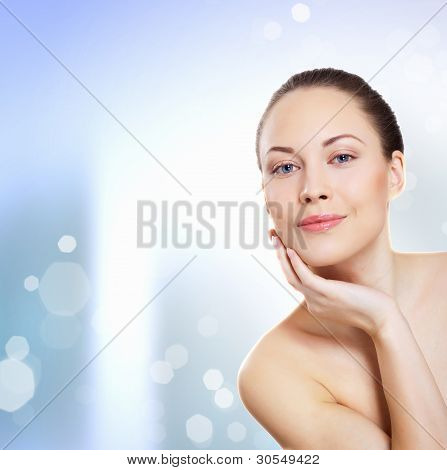 Young woman with water splashes