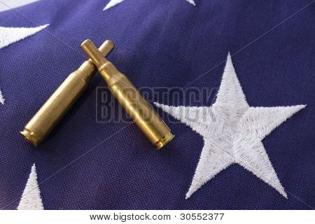 Military Funeral Flag and Bullets