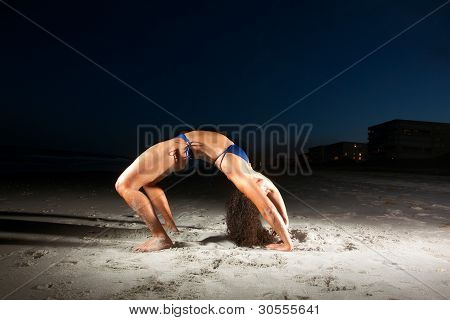 Young Brunette Woman Stretching On Beach