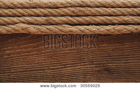 old texture of wooden boards with ship rope.