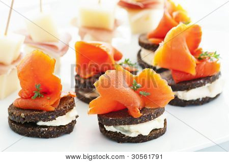Finger food with salmon and ham