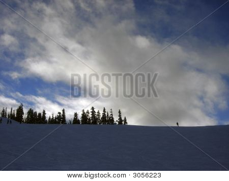 Lonely Skier On A Ridge Of A Ski Slope