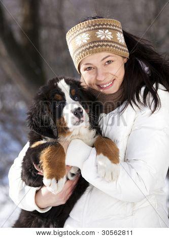 Bernese sennenhund puppy and girl.