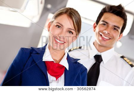Airplane cabin crew with pilot and flight attendant smiling