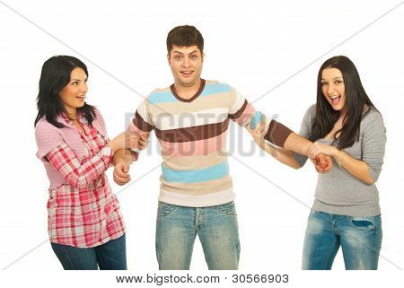 Surprised Man Between Two Women