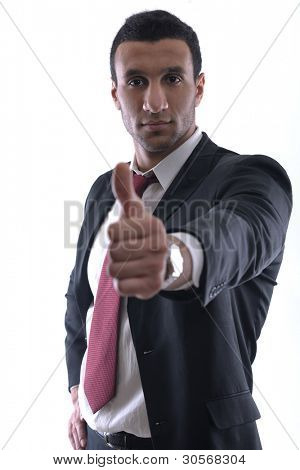 Businessmen making his thumb up saying OK sign symbol  isolated on white background in studio
