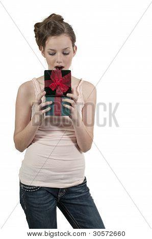 A Beautiful Woman Opening A Present