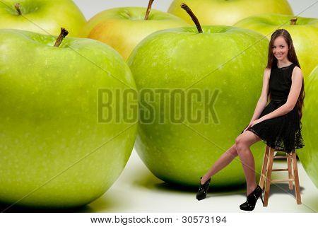 Teenage Woman Sitting Beside Apples