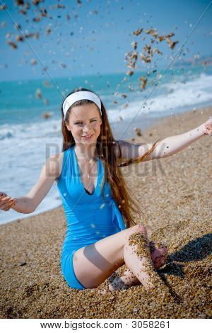 Woman Playing With Sand At Beach
