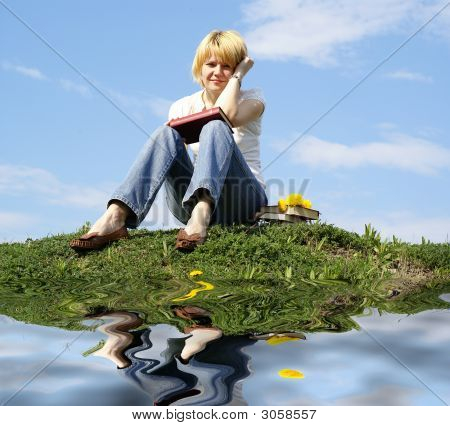 Female Student Outdoor On Green Grass With Books And Blue Sky  Background