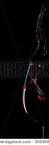 red wine splash silhouette isolated on black background