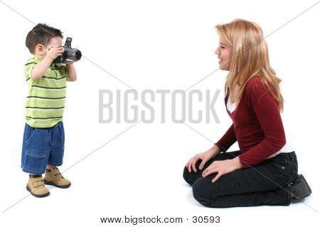 Child Photographer And Model Over White