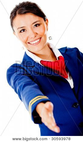 Welcoming air hostess with hand extended �?�¢?? isolated over a white background