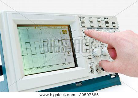 Engineer Operating A Digital Oscilloscope